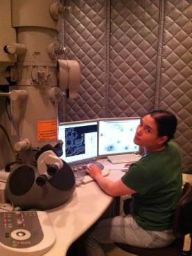 """Altaira Dearborn, Ph.D. says: """"Here's a pic of me on the F20 electron microscope. That particular experiment did not work, but it just meant I had to revise the model."""""""